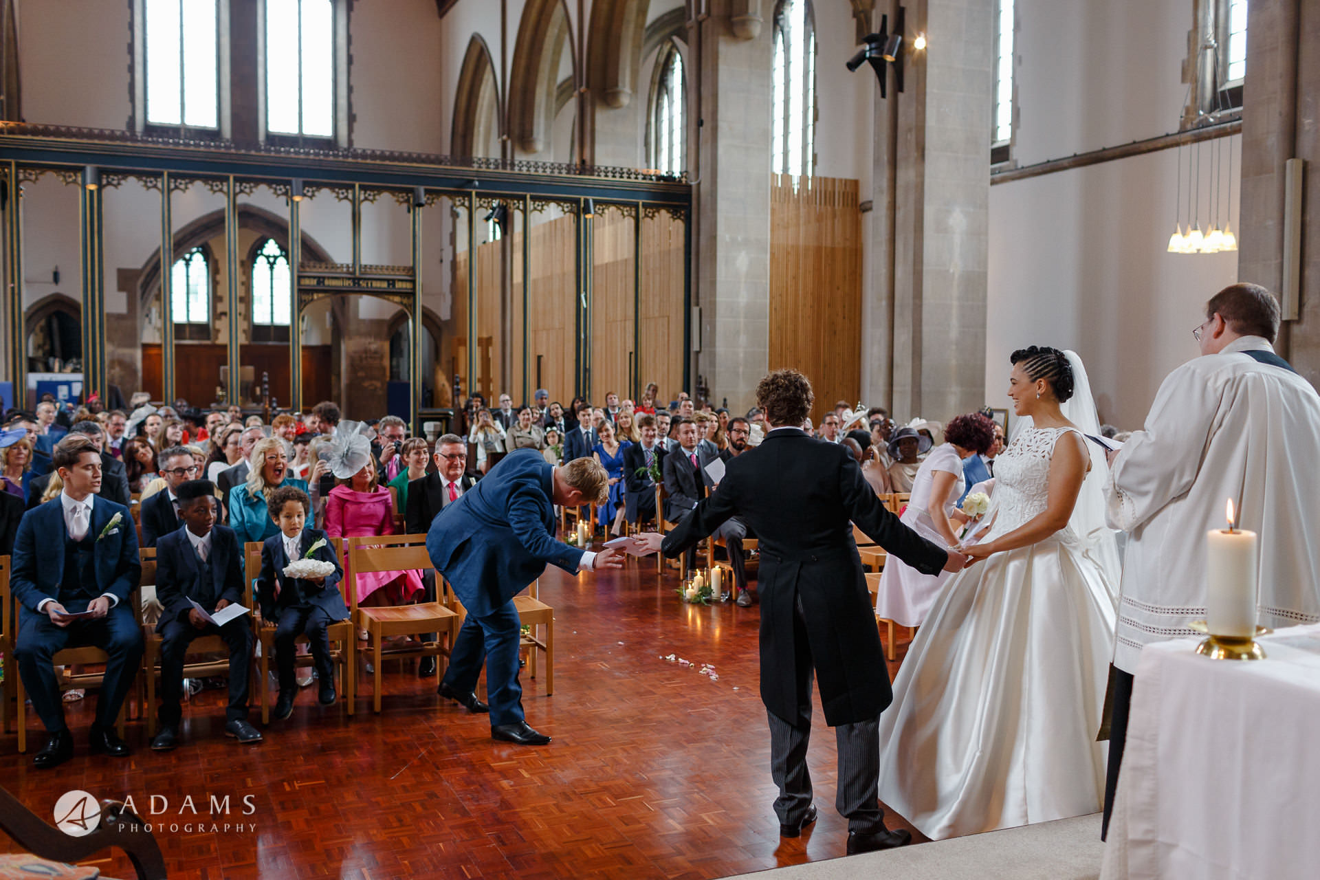bestman is passing the ring to the groom at st mary of eton church hackney wick