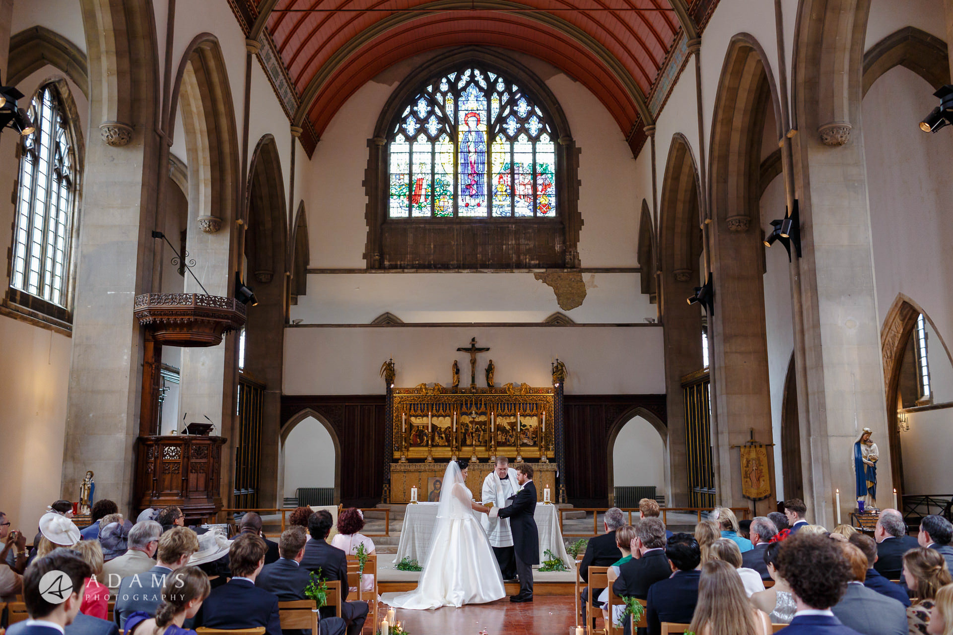 Bride and Groom standing at the alter at st Mary of Eton church in hackney wick during their wedding ceremony