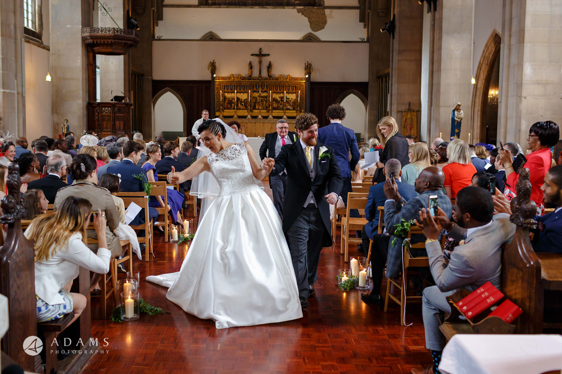 Bride and Groom walking down aisle at st Mary of Eton church in hackney wick during their wedding ceremony