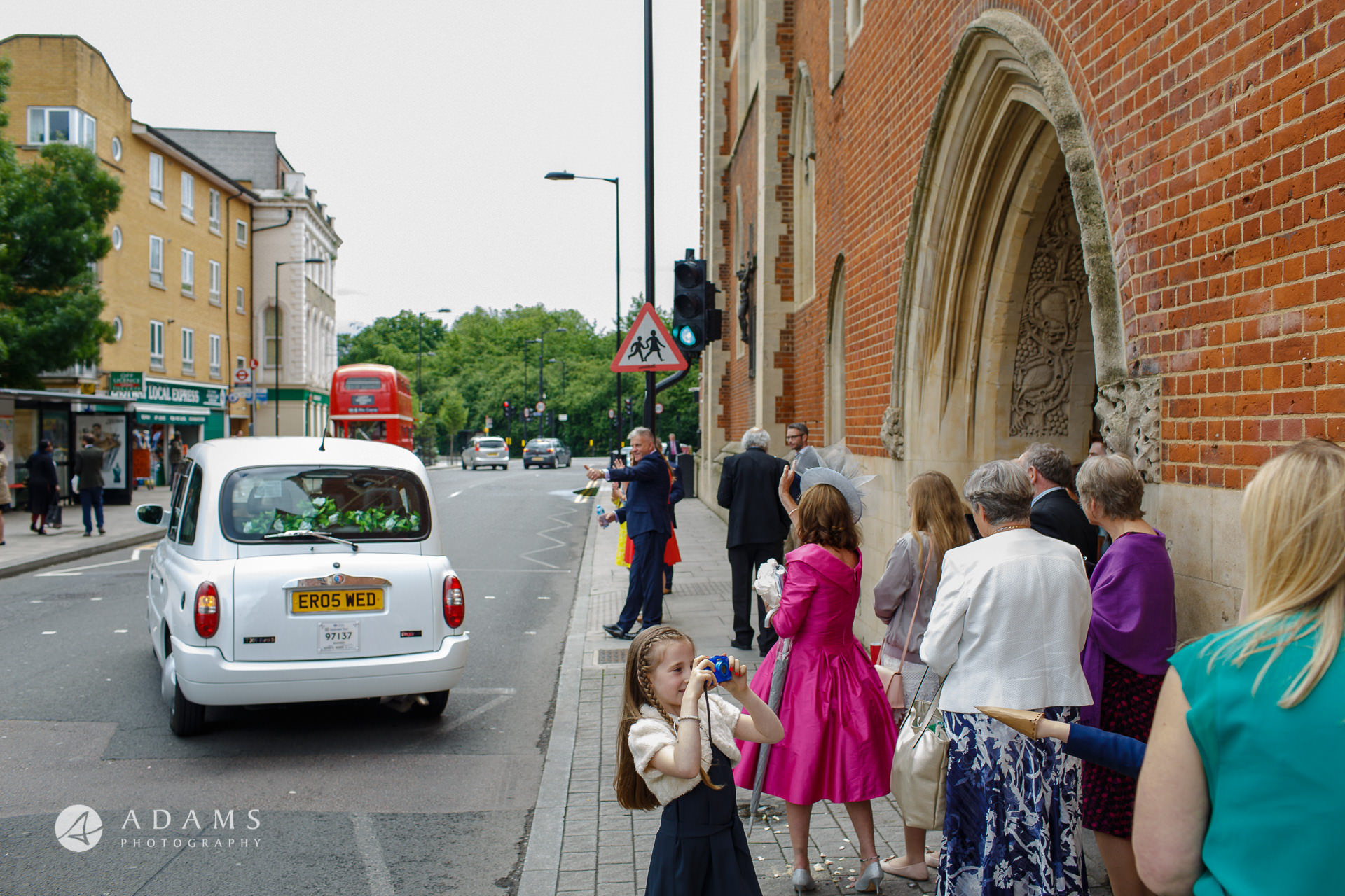 married couple in a white London can on their way to Morden Hall