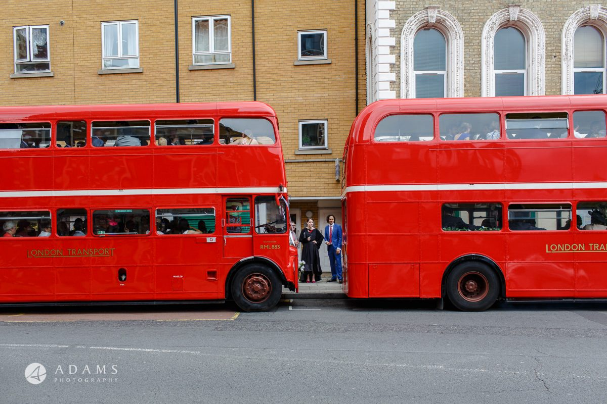 red route master busses full of guests on before they go for wedding reception at Morden Hall