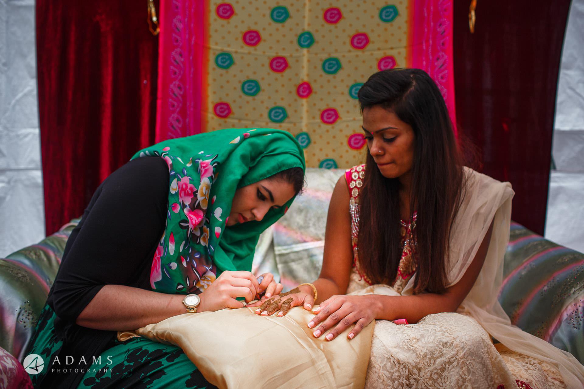 women making the bride tamil wedding tatoos
