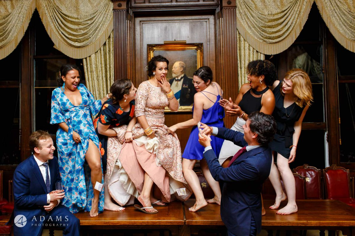 middle temple hall wedding photography bridal party dancing on the table