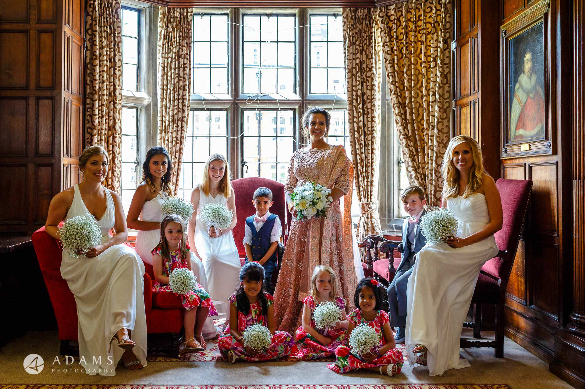 middle temple hall wedding bridal party photo by the window
