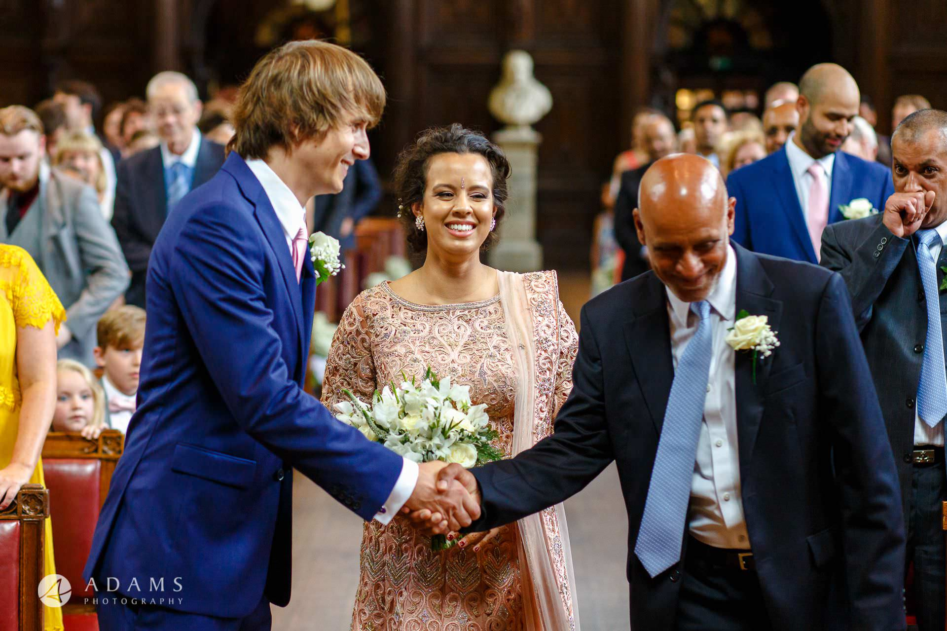 middle temple hall wedding father of the bride shake hand of the groom