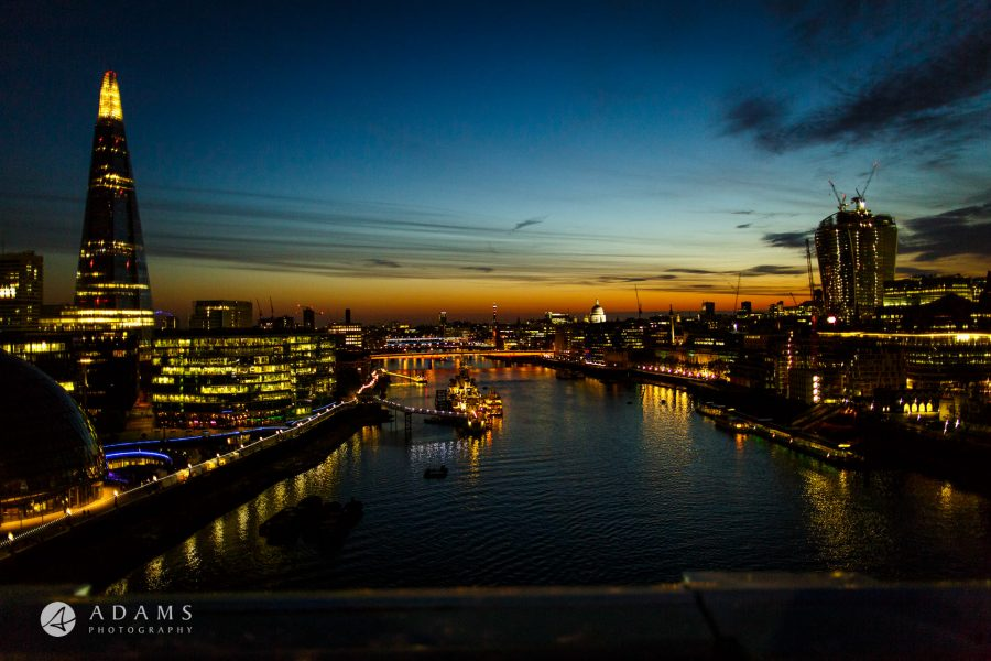 view from Tower Bridge on the River Thames and London taken by a wedding photographer during a wedding