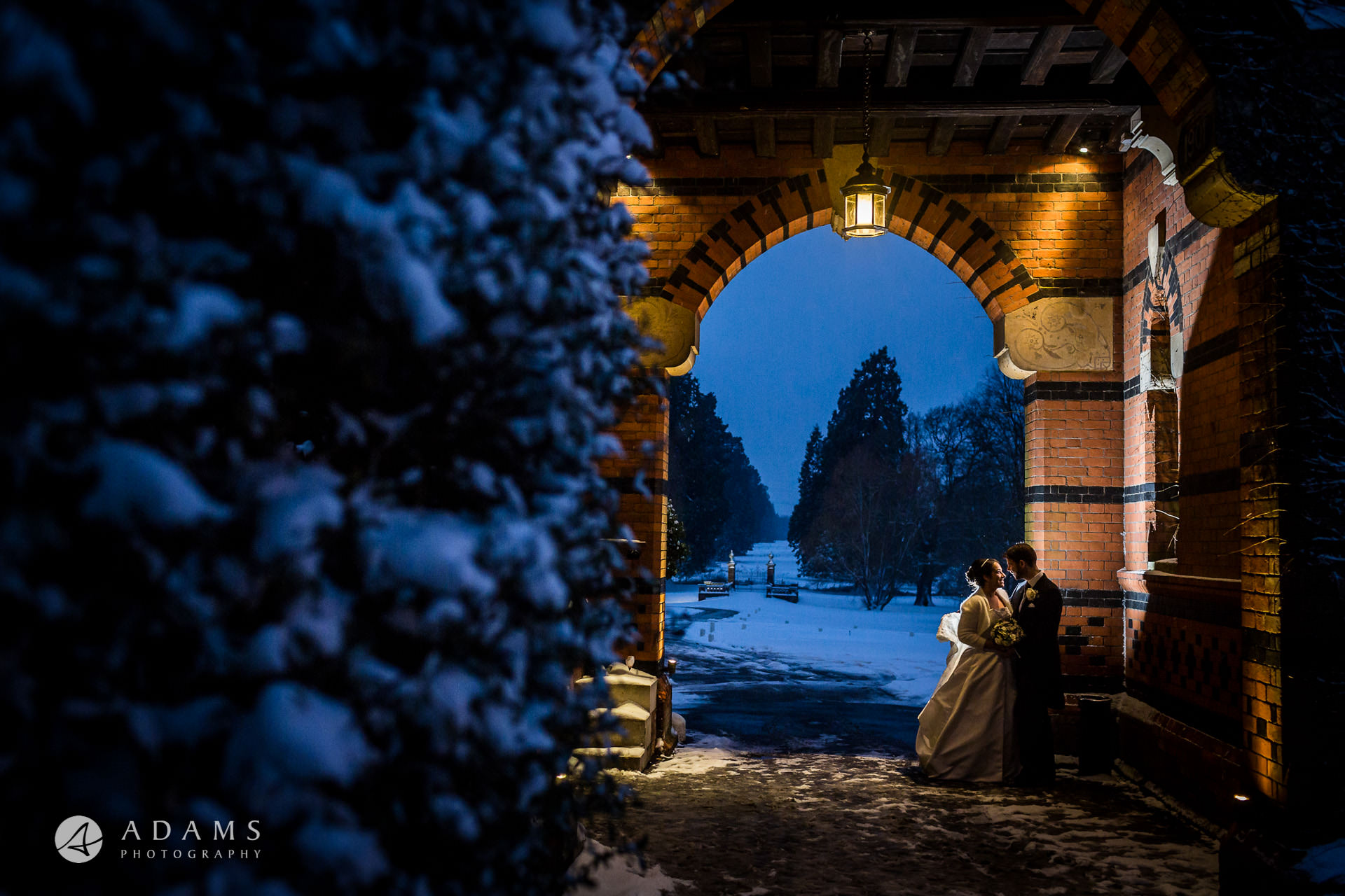 winter shoot of a couple with snow by wedding photographer London