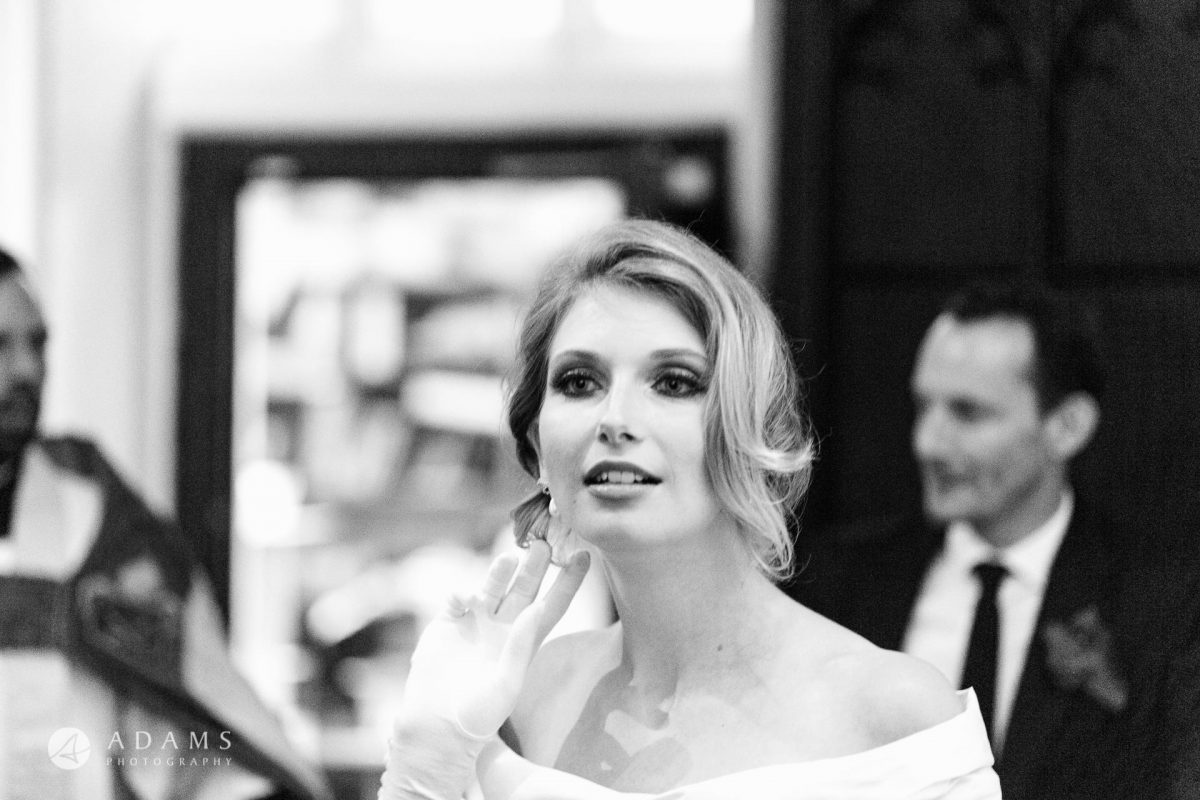 Black and White Wedding Photography bride is fixing her hair