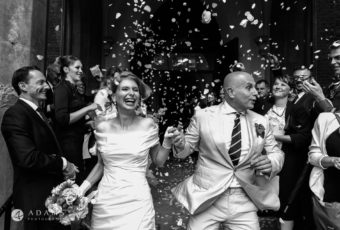 confetti over happy married couple London wedding