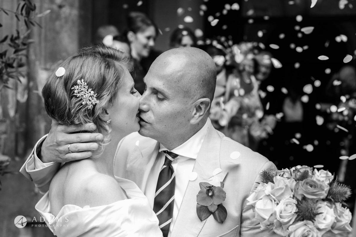 Black and White Wedding Photos couple kissing