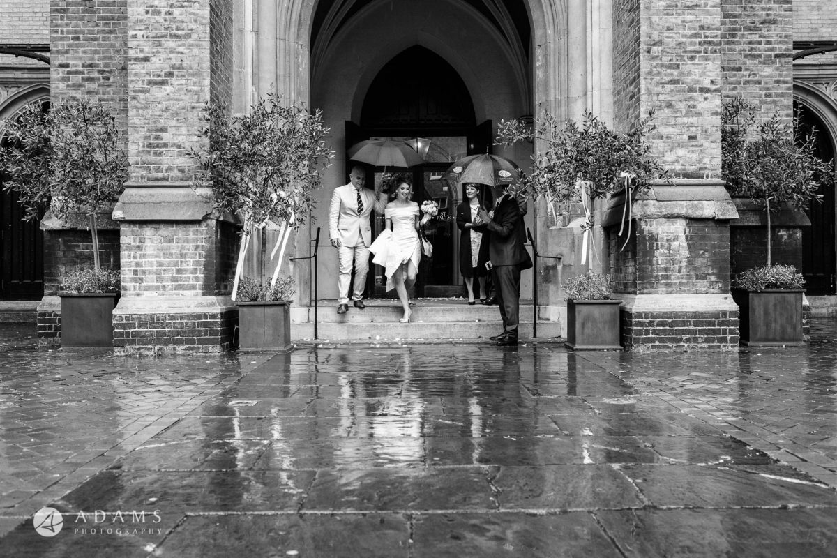 black and white wedding photos the couple walks in the rain