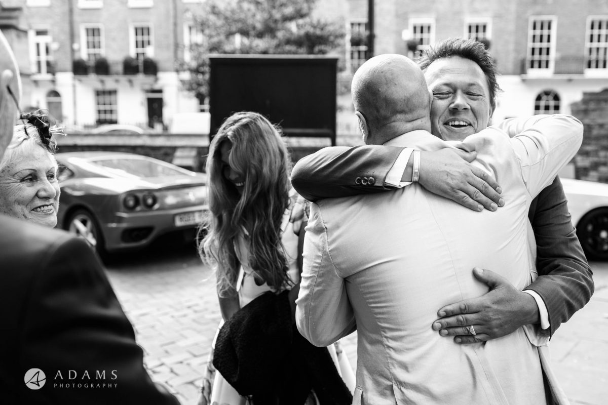 Black and White Wedding Photography gusts hugging