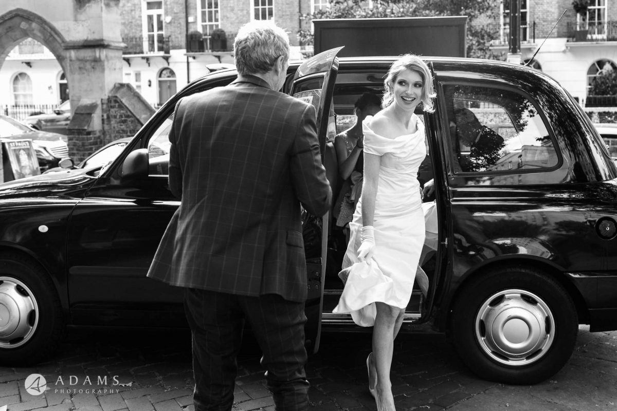 Black and White Wedding Photography bride is getting of the car