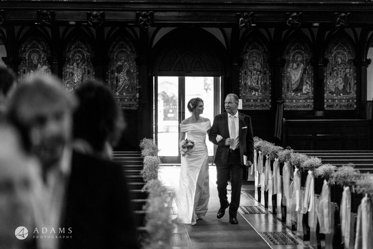 Black and White Wedding Photography bride walking down the aisle with the father