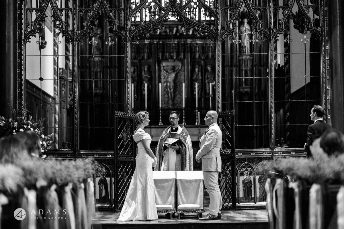 Black and White Wedding Photography the couple is saying their vows
