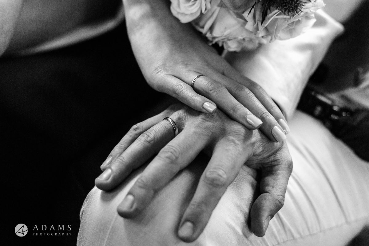 black and white wedding photos the couple holding hands