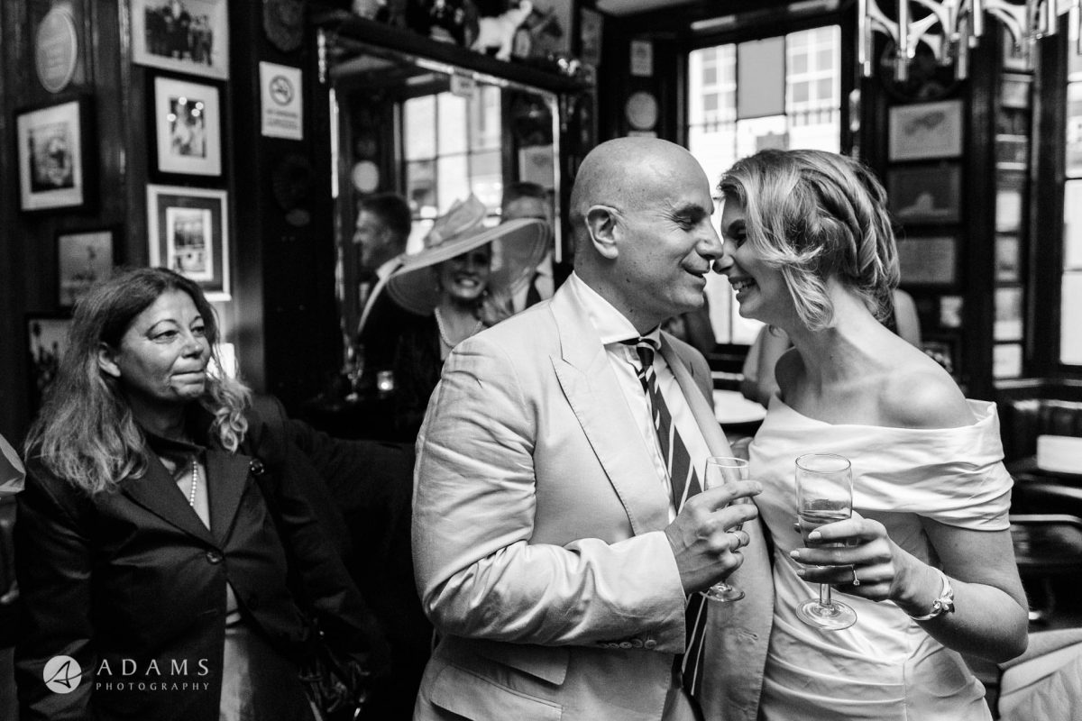 black and white wedding photos the couple are having an intimate moment