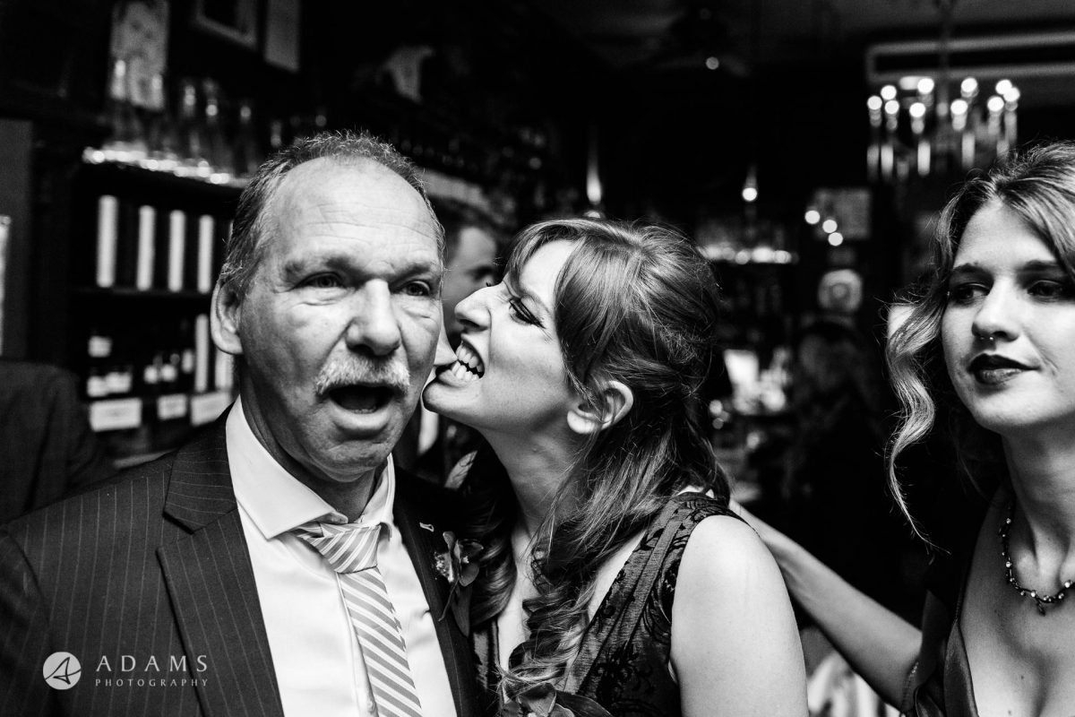 black and white wedding photos bridesmaid is king her father ear