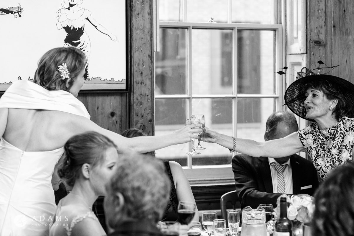 black and white wedding photos guests drink