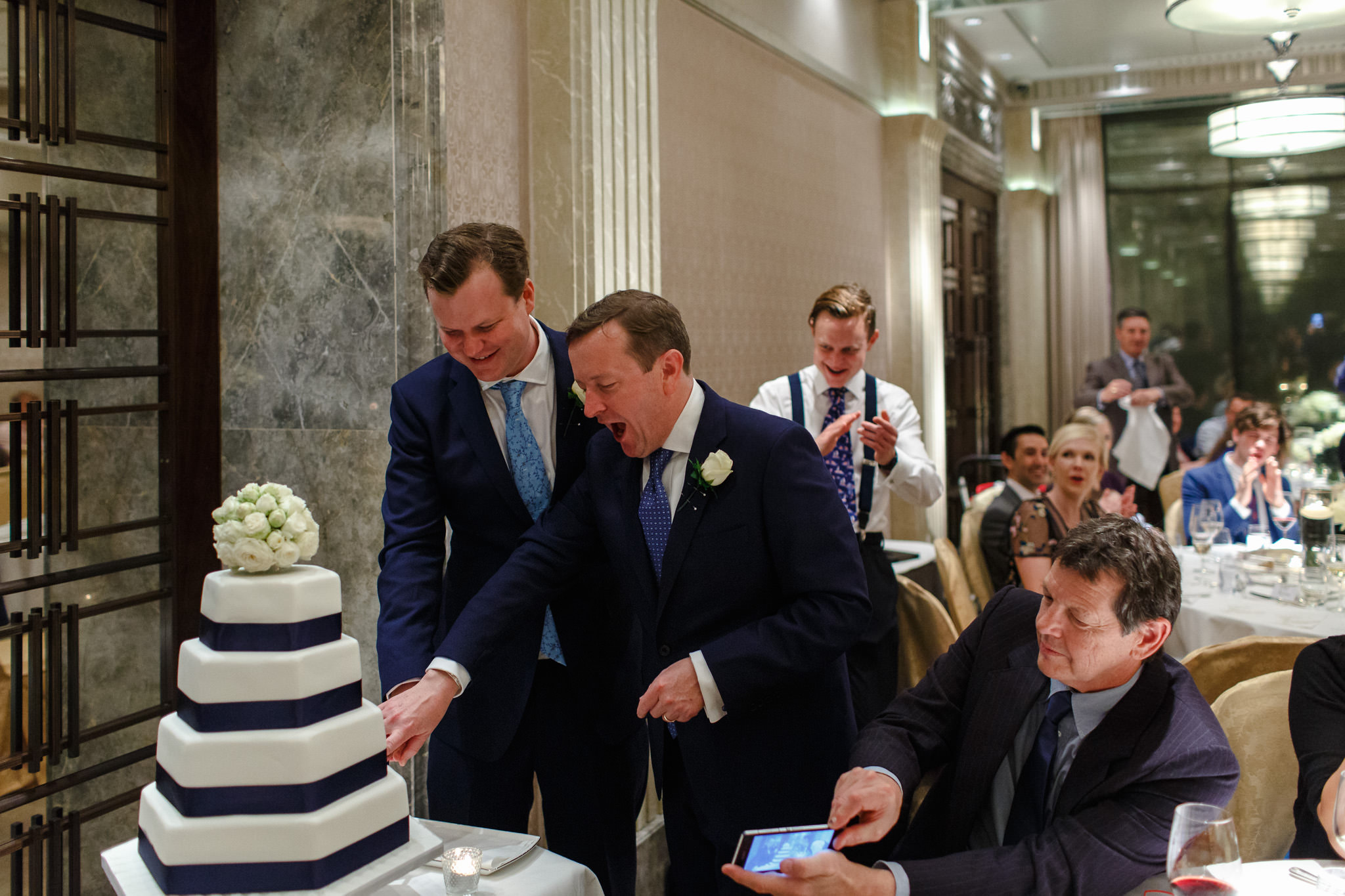 Connaught Hotel Wedding Photos The grooms cut the cake