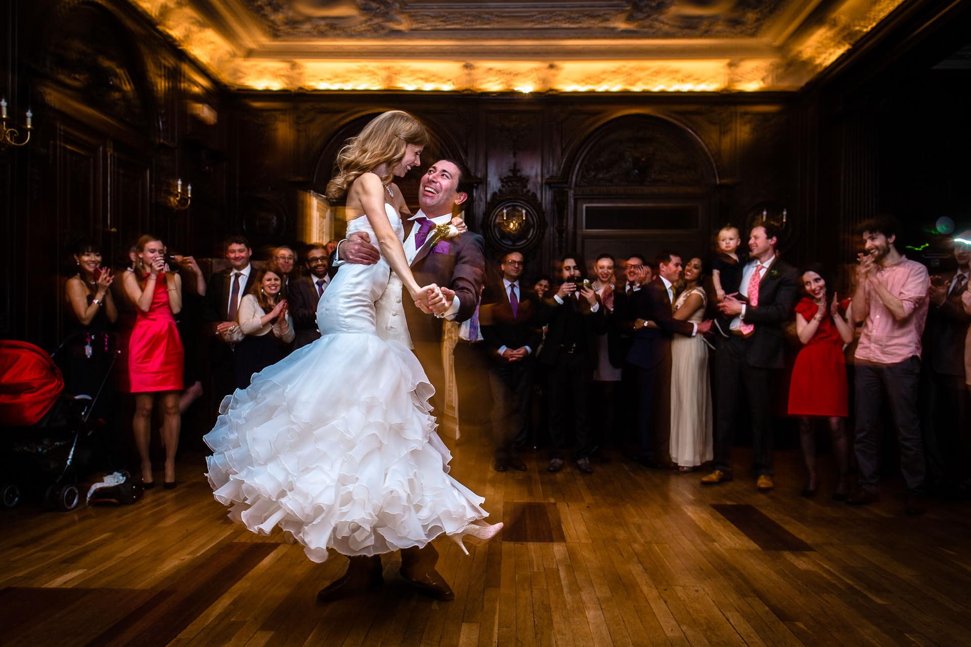 first dance at wedding in London - groom is looking in the eyes of bride