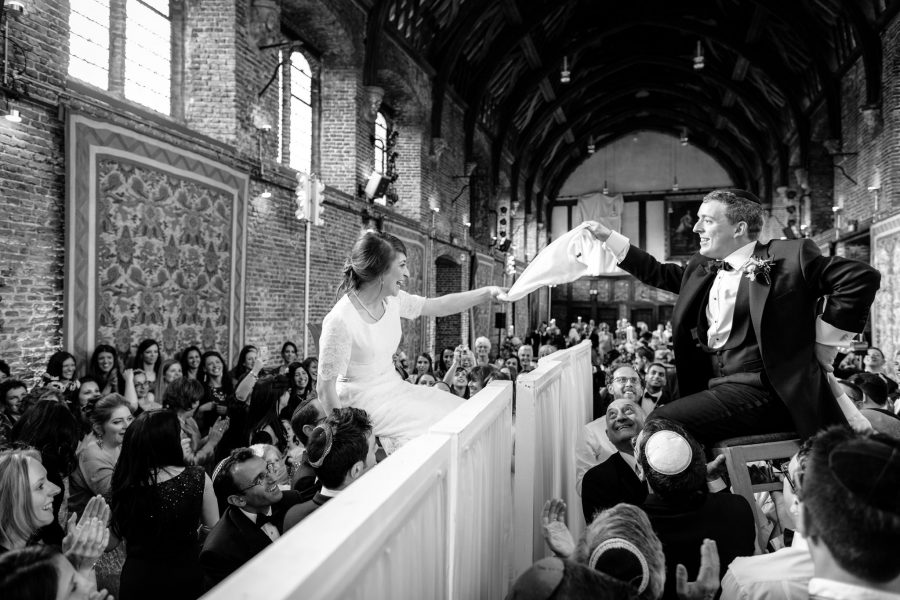 Hatfield House wedding bride and groom on the chairs in the air