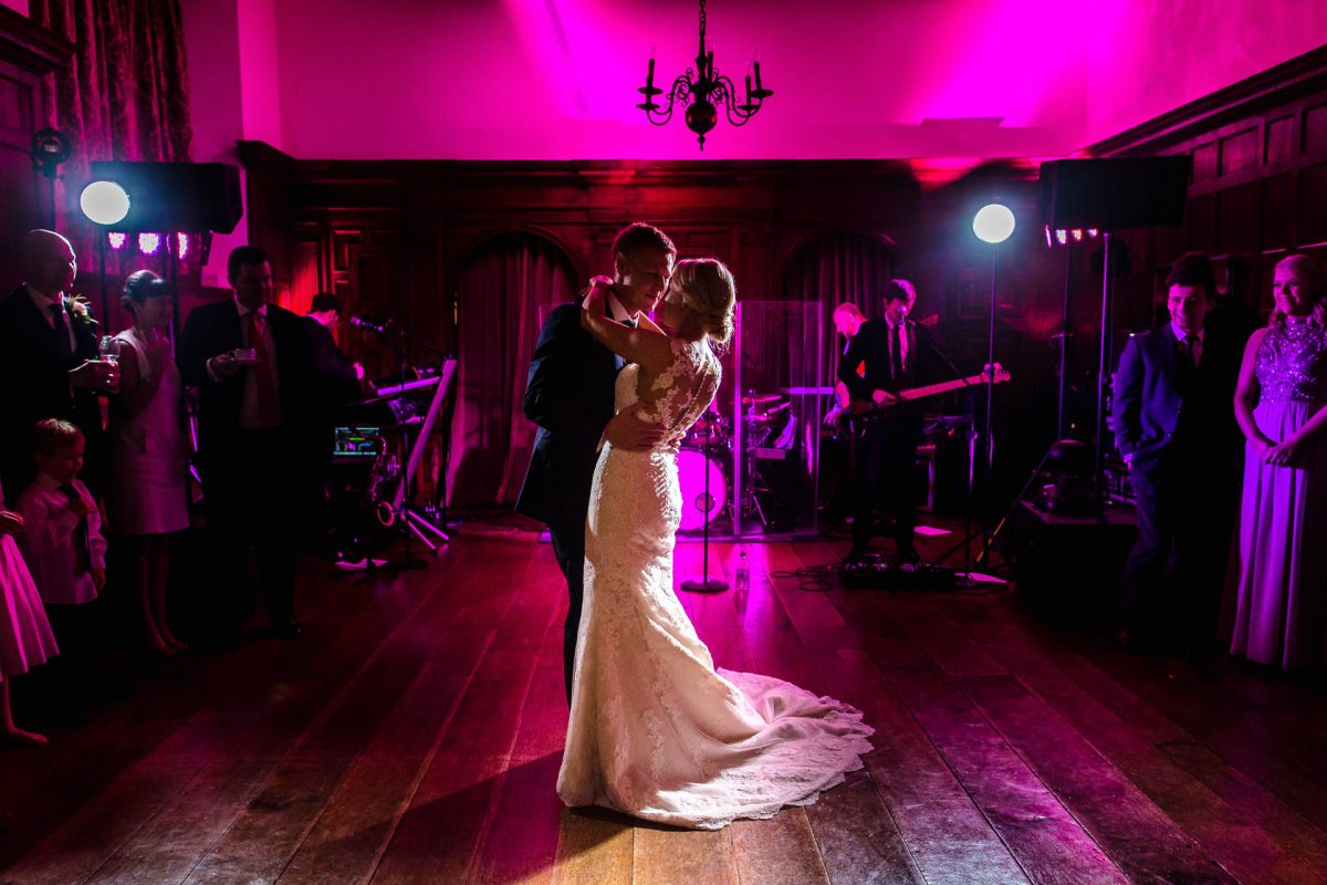wedding couple are dancing their first dance