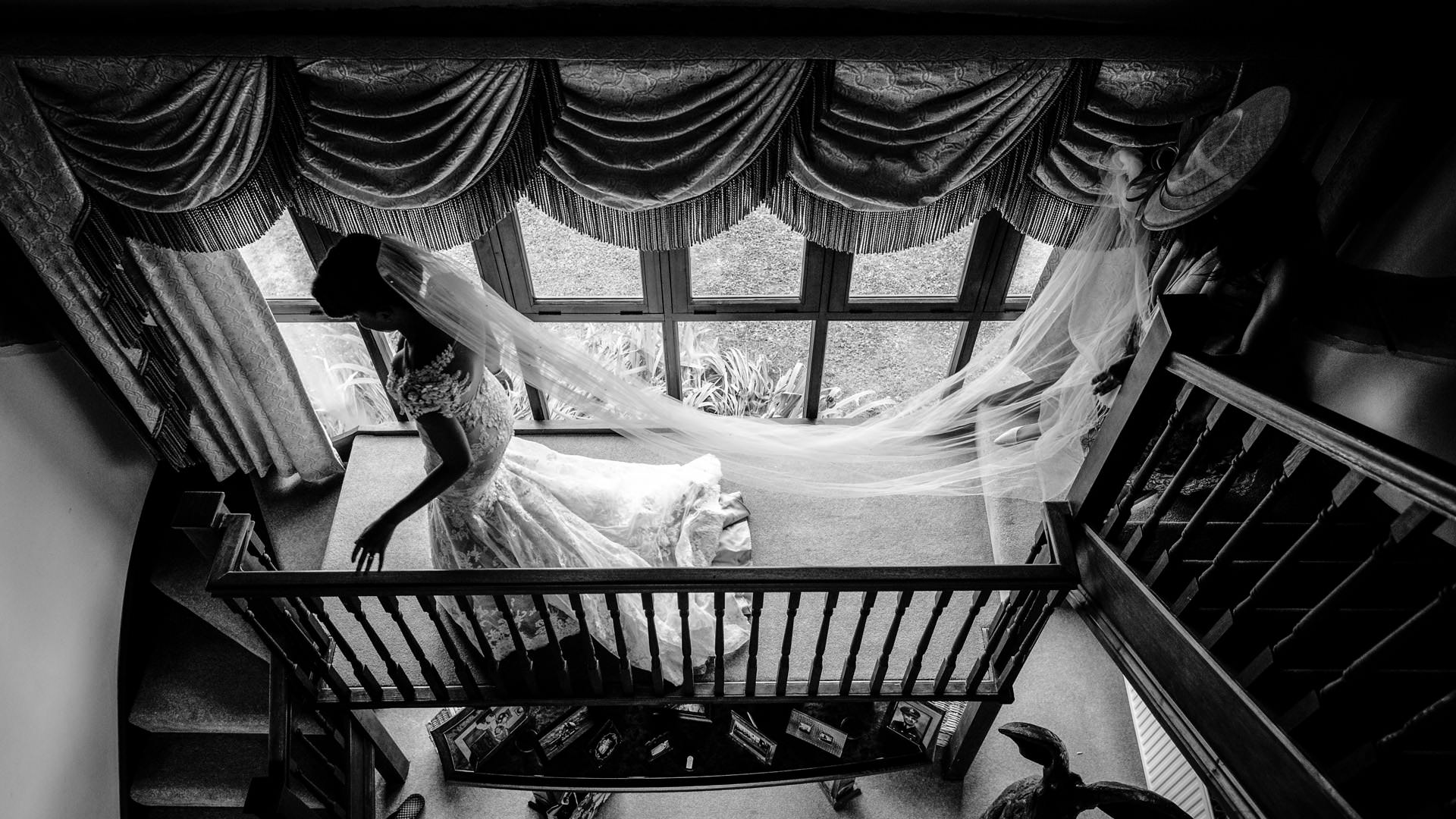 bride going down the stairs at her home the Berkshire wedding photography