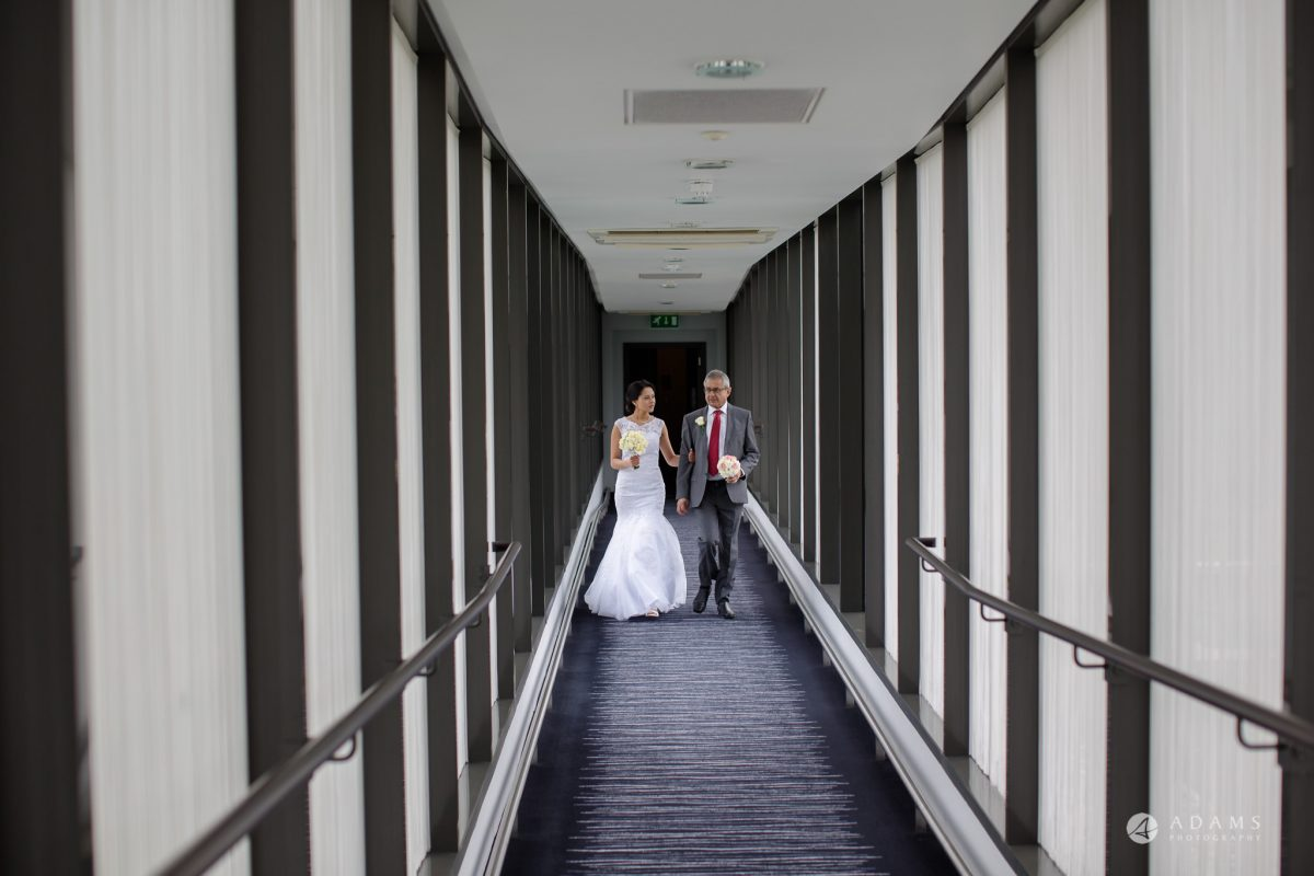 Hilton London Syon Park Asian Wedding bride walking with her father
