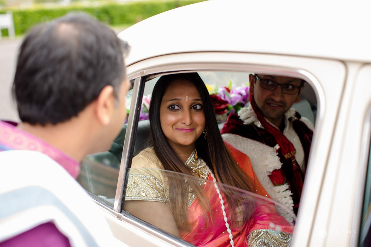 Hilton London Syon Park Asian Wedding groom arrives in the car