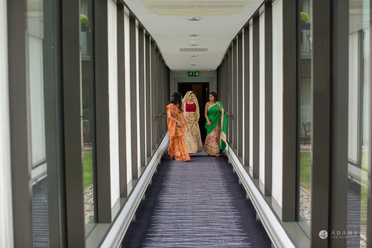 Hilton London Syon Park Asian Wedding bride walks in her sari
