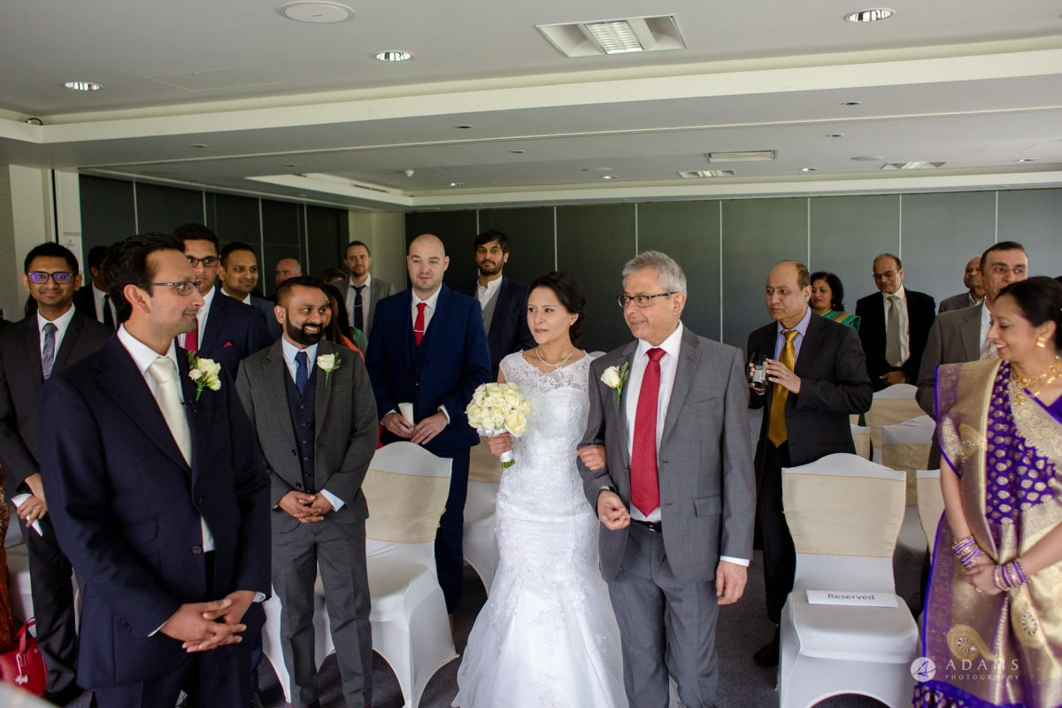 Hilton London Syon Park Asian Wedding bride walking down the aisle