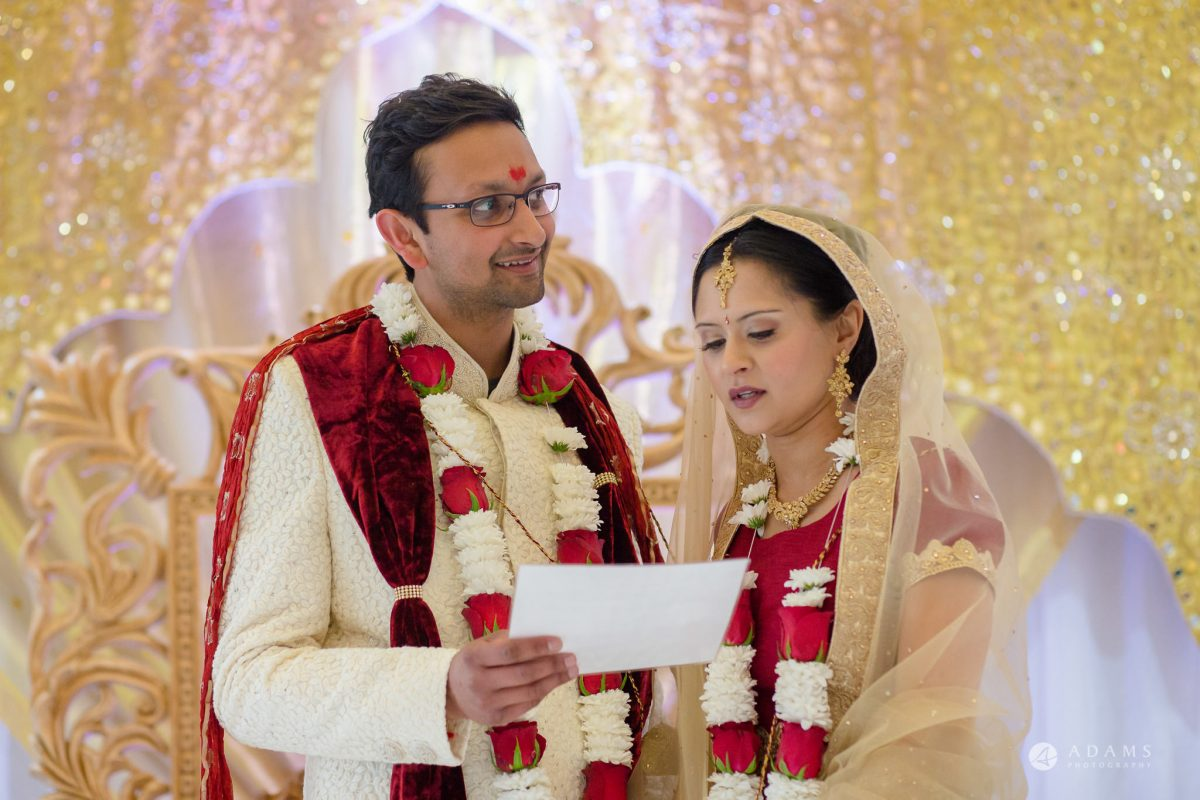 Hilton London Syon Park Asian Wedding groom reads a letter