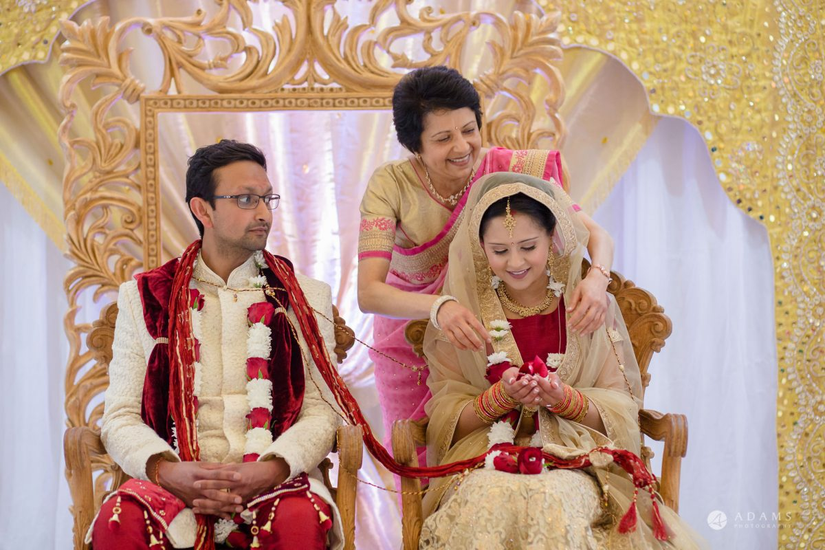 Hilton London Syon Park Asian Wedding couple sitting