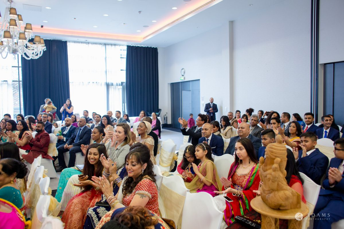 Hilton London Syon Park Asian Wedding guests watching the hindu ceremony