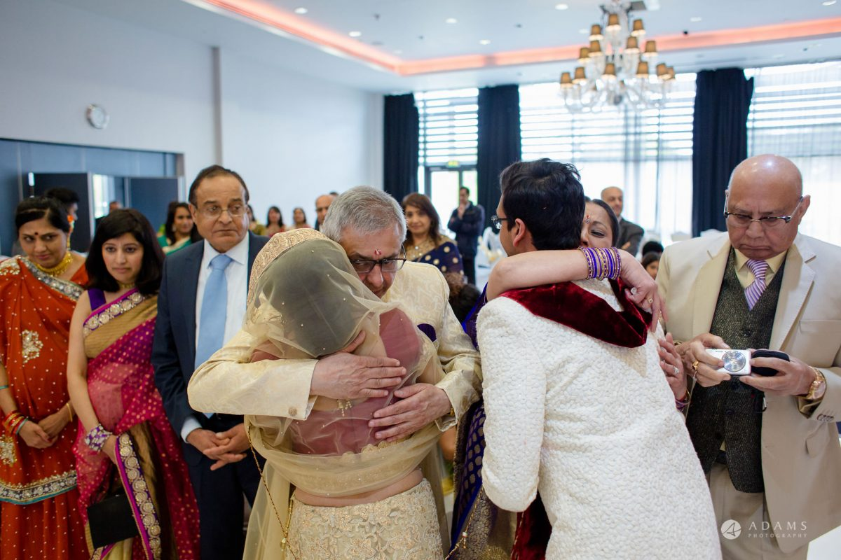 Hilton London Syon Park Asian Wedding family hugs
