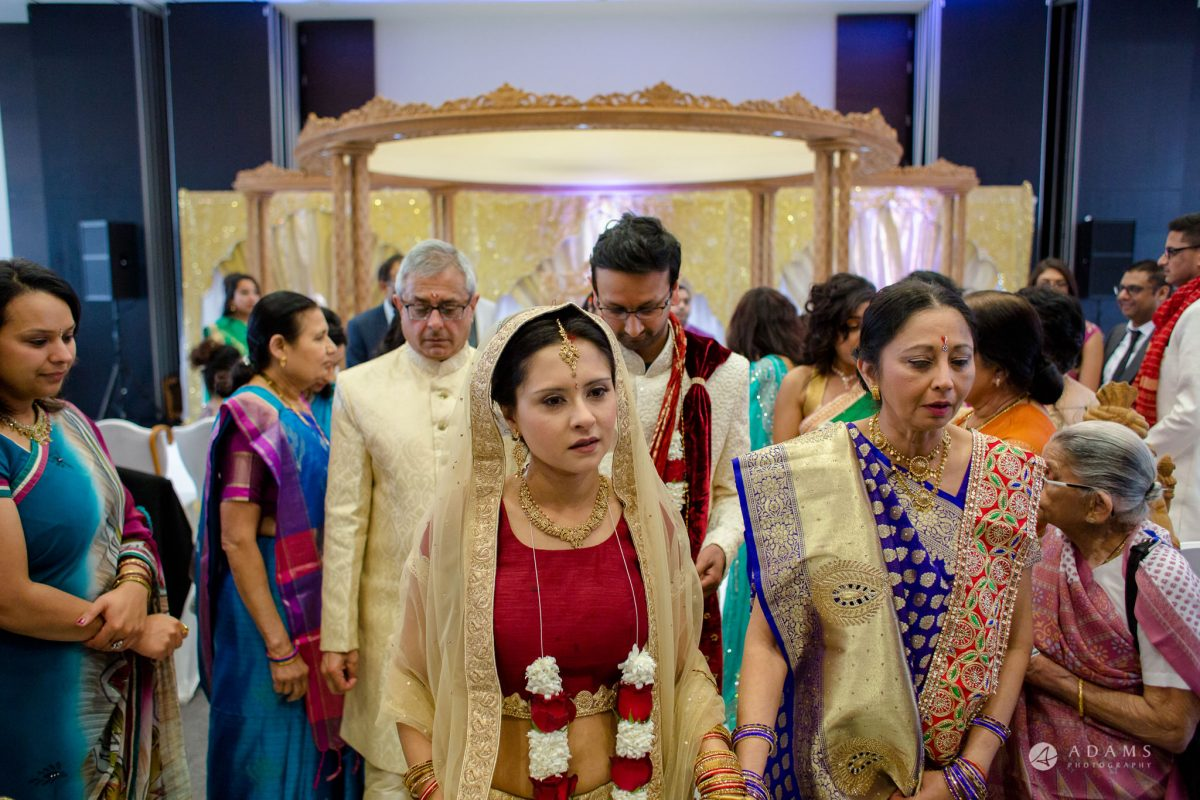 Hilton London Syon Park Asian Wedding the couple leave the room