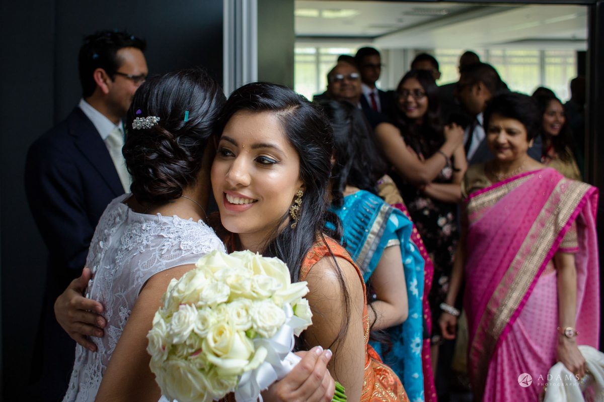 Hilton London Syon Park Asian Wedding bridesmaid hugs the bride