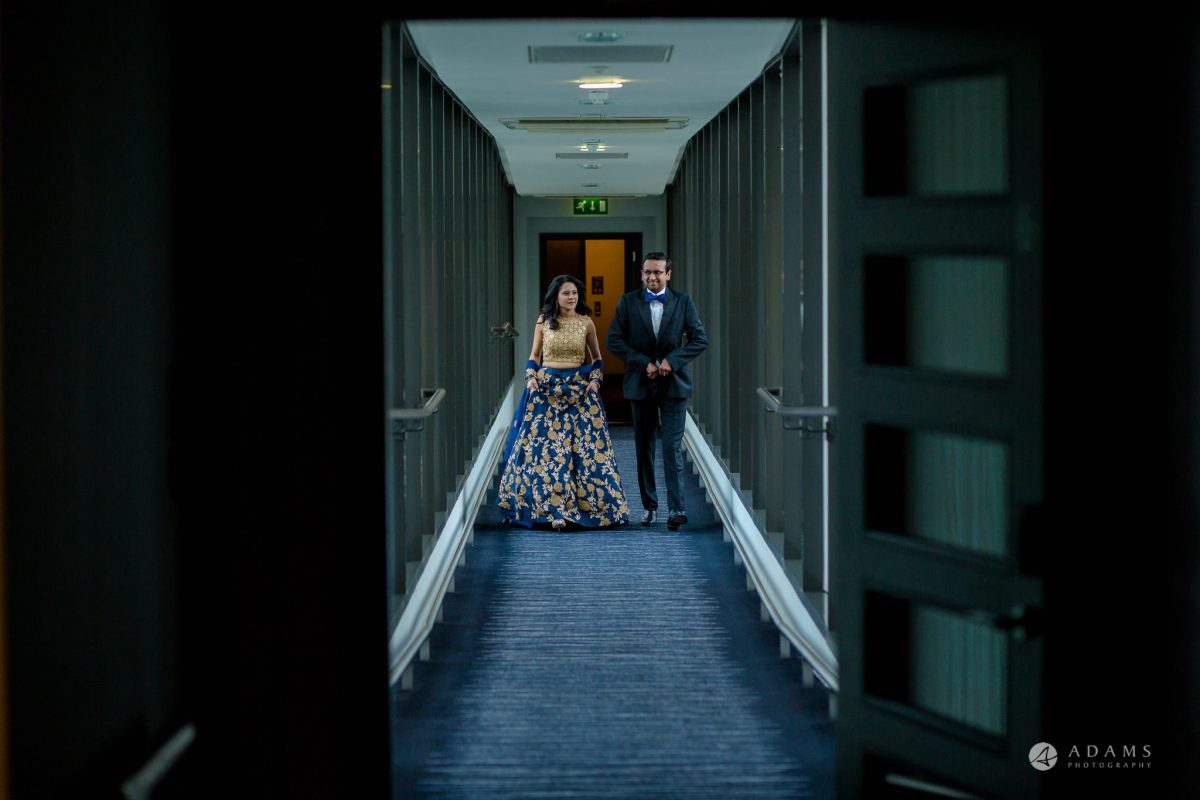Hilton London Syon Park Asian Wedding bride and groom walk together