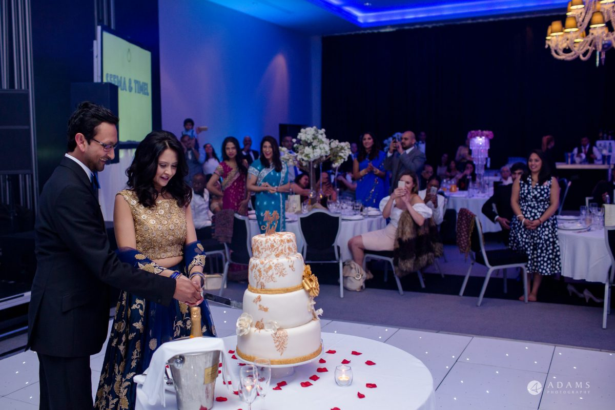 Hilton London Syon Park Asian Wedding cake cutting
