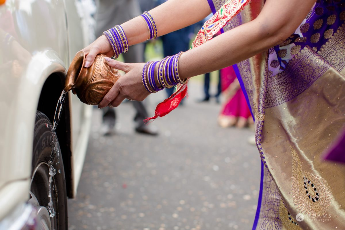 Hilton London Syon Park Asian Wedding blessing the car
