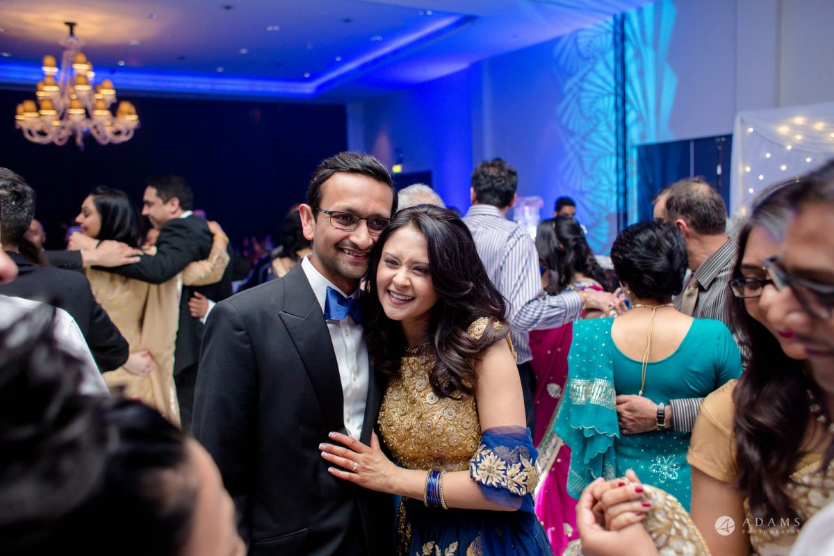Hilton London Syon Park Asian Wedding couple cuddle