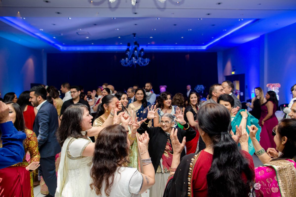 Hilton London Syon Park Asian Wedding everybody on the floor dancing
