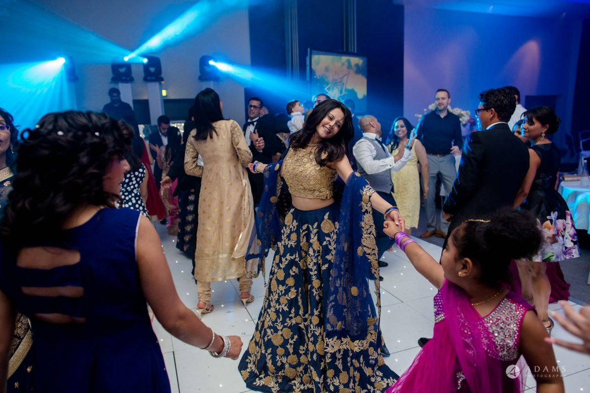 Hilton London Syon Park Asian Wedding bride dancing with a little girl