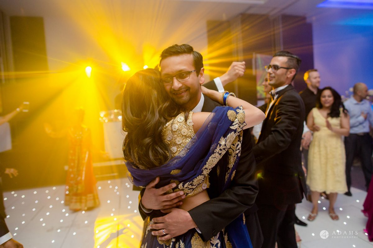 Hilton London Syon Park Asian Wedding groom hugs the bride