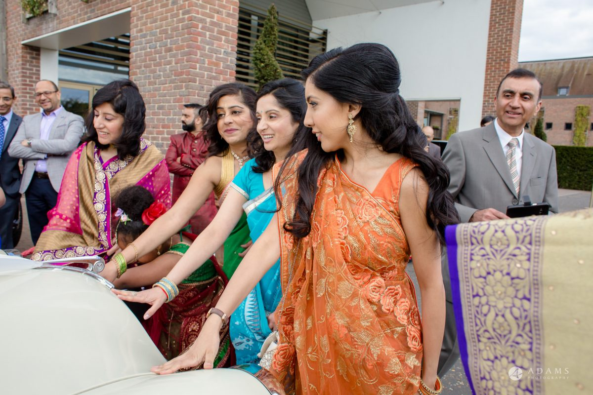 Hilton London Syon Park Asian Wedding bridesmaids stoping the car