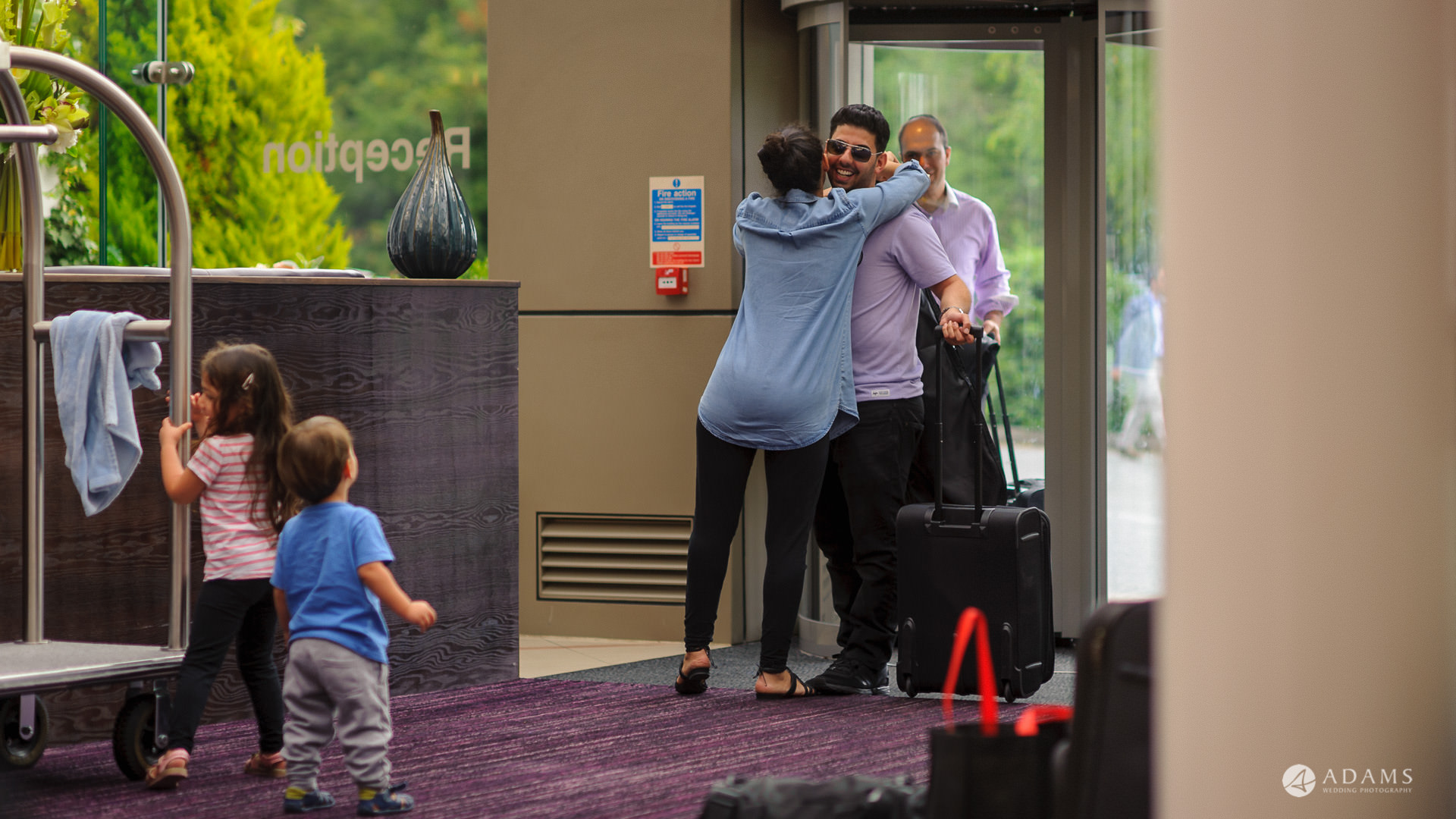Manor of Groves Hotel Wedding Photographer groom welcomed by family