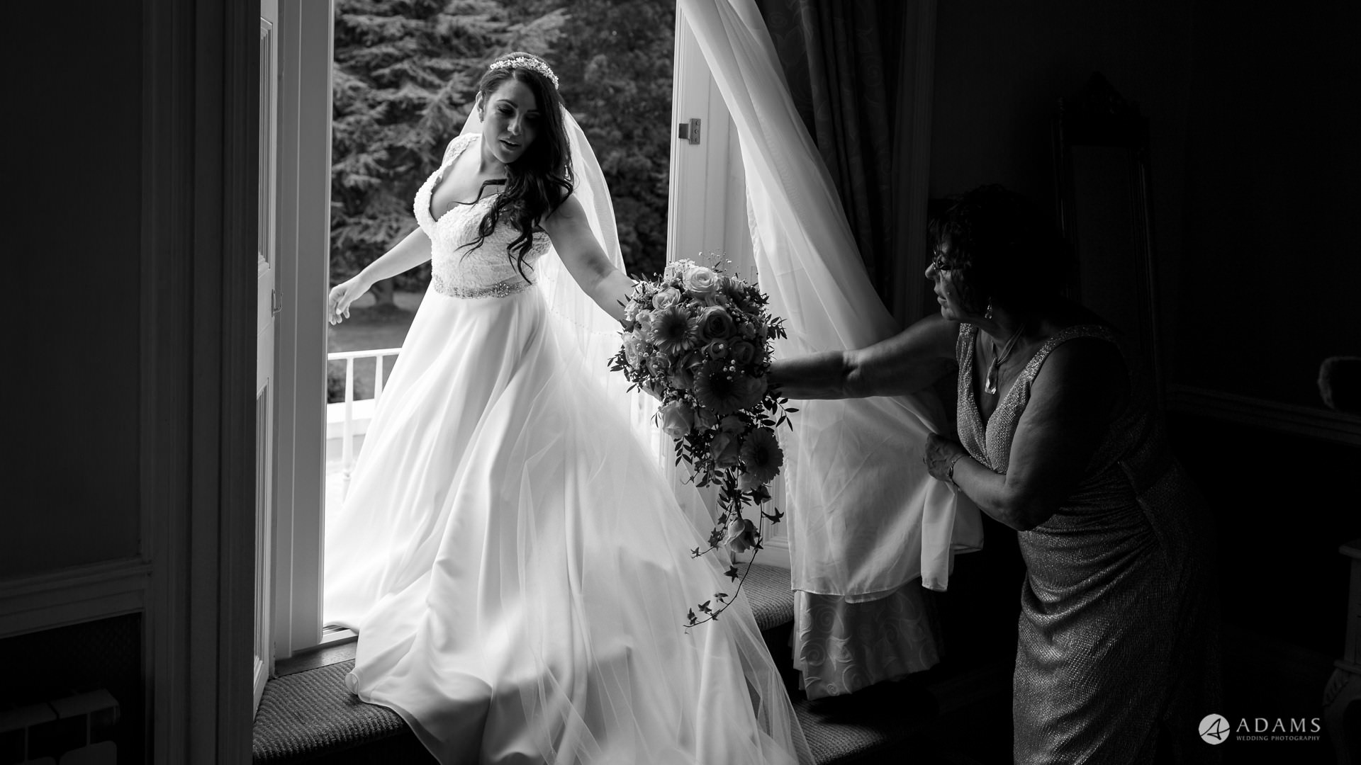 Manor of Groves Wedding bride holds bouquet