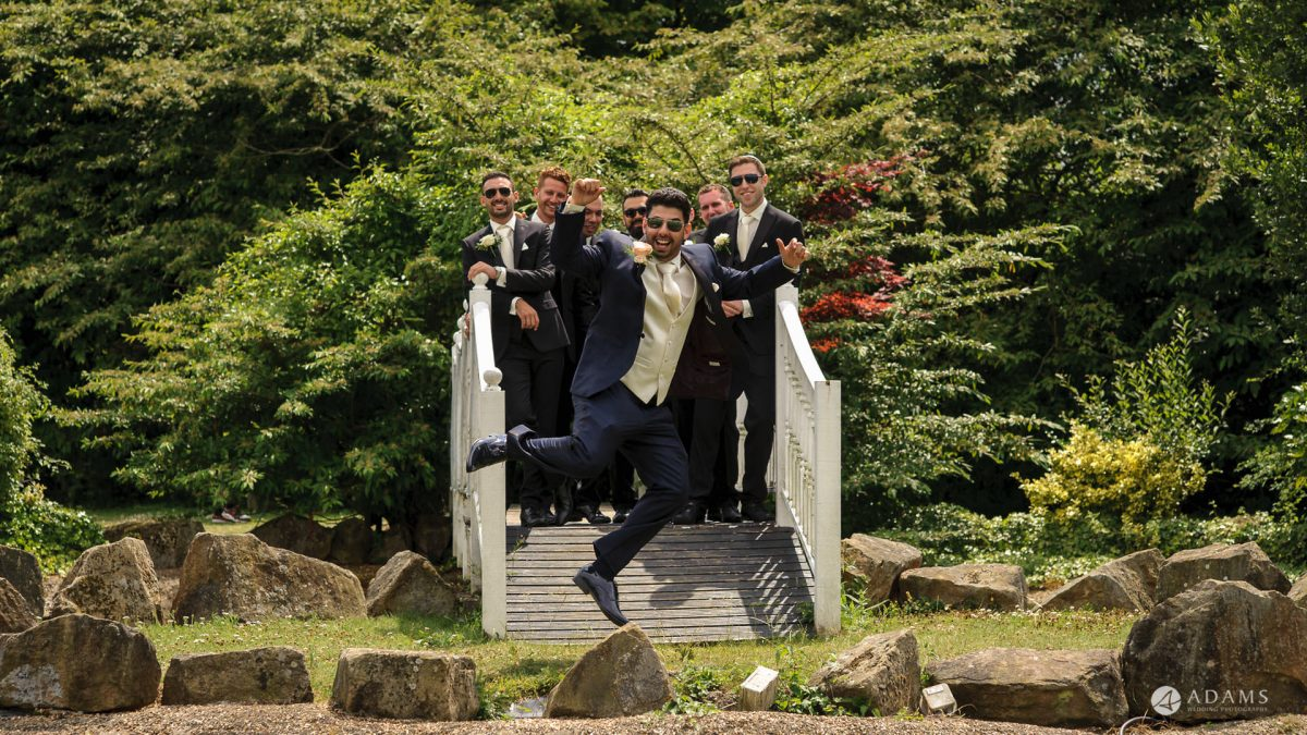 Manor of Groves Wedding groom flying in the aire