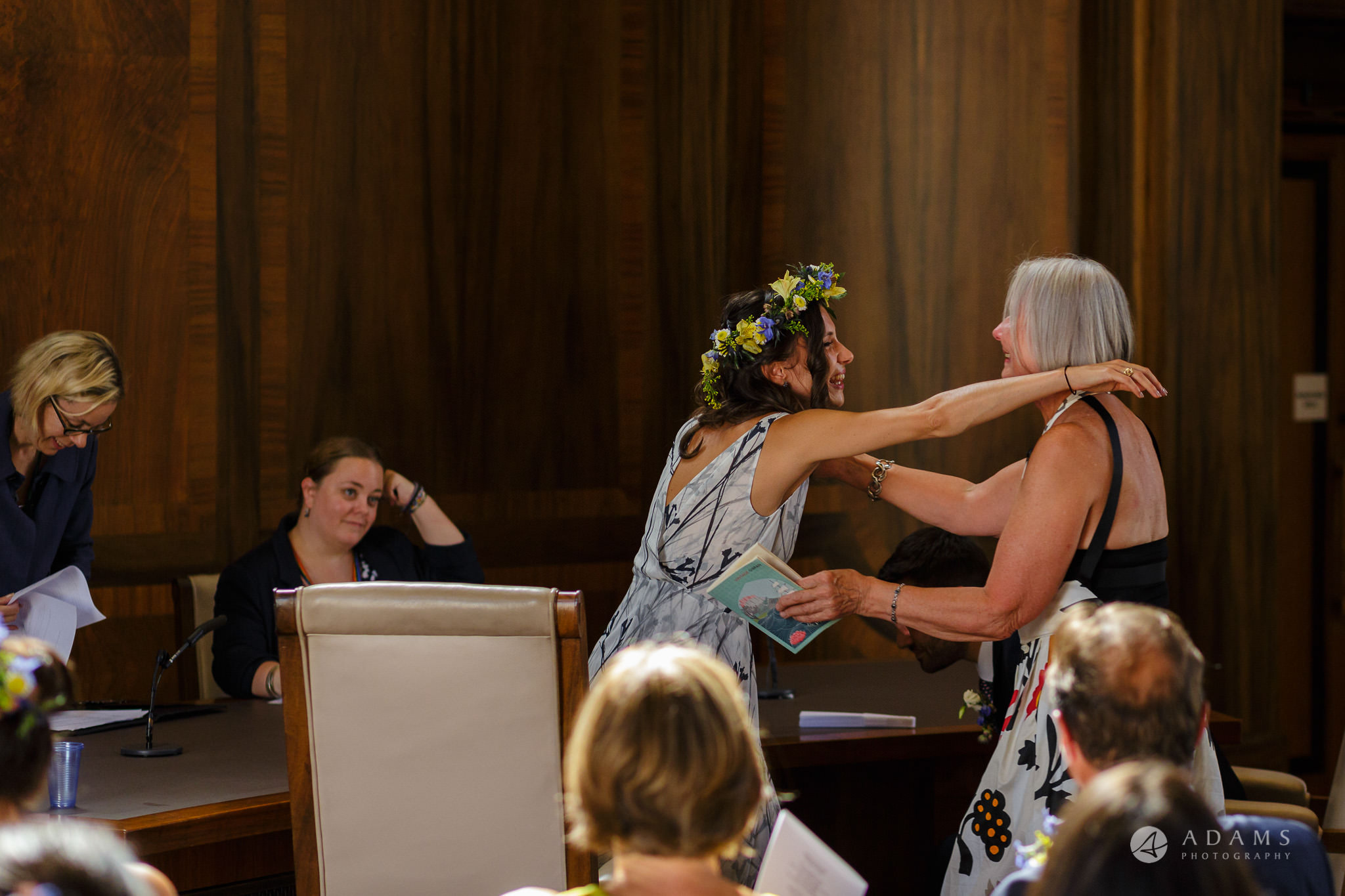 Clissold house wedding bride is going to hug the mother of the groom